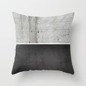 raw-concrete-and-black-leather-pillows