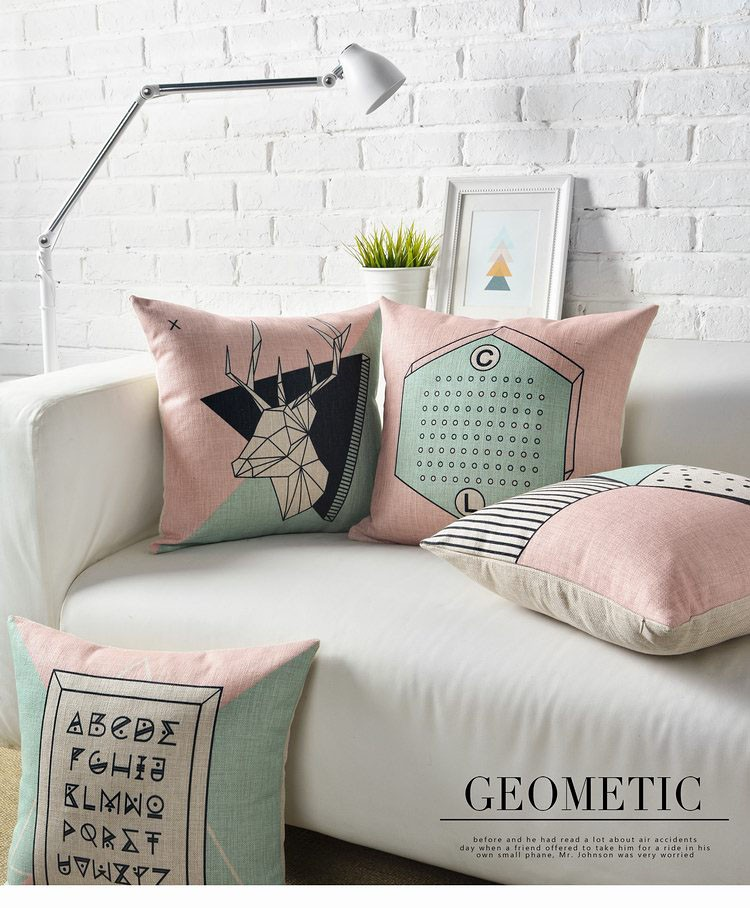 Pink and mint geometric throw pillows